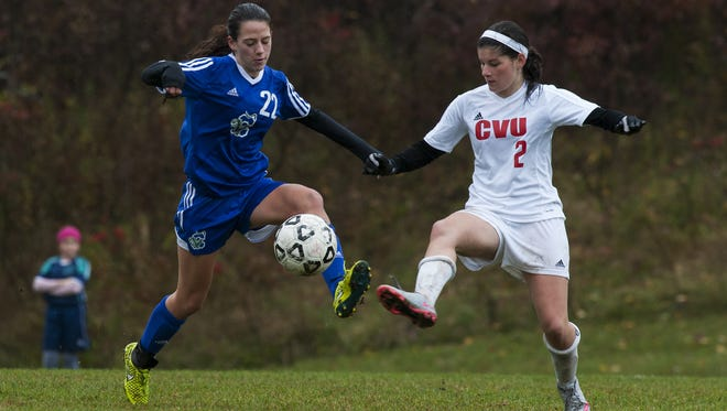 Colchester's Summer Hathaway (22) and CVU's Ali Bisaccia (2) battle for the ball during a high school girls soccer game against Saturday.