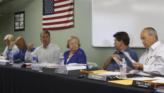 Members of the Fort Thomas City Council safety committee and Mayor Mary H. Brown discuss the city's pit bull ban inside the Fort Thomas Armory in Tower Park Aug. 4, 2014.