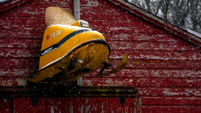 One of the most icon snowmobiles of all time, a late 60's Ski Doo adorns one of Jeff's outbuildings.