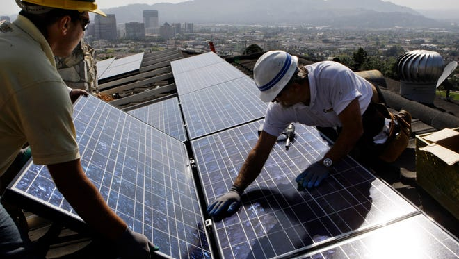 Installing solar electrical panels in Glendale, Calif.