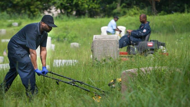 Damon Johns (left) of Newark cleans up Mt. Zion last summer.