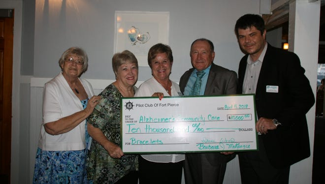 "The Pilot Club of Fort Pierce's ""Birdies for Bracelets"" golf tournament raised $10,000, which was donated to Alzheimer's Community Care. Pictured are, from left, Jan Smith, Tena Sigmon, Mary Barnes, Bob Gorman, and Jonathan Price."