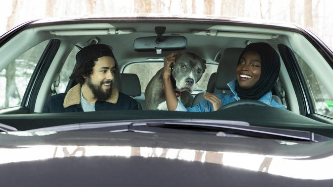 "Ramy Youssef with MaameYaa Boafo (and Boomer) in a scene from Season 2 of ""Ramy."""