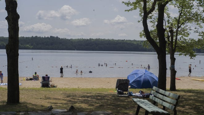 Sterling residents enjoy the nice weather at Sterling Town Beach last week.