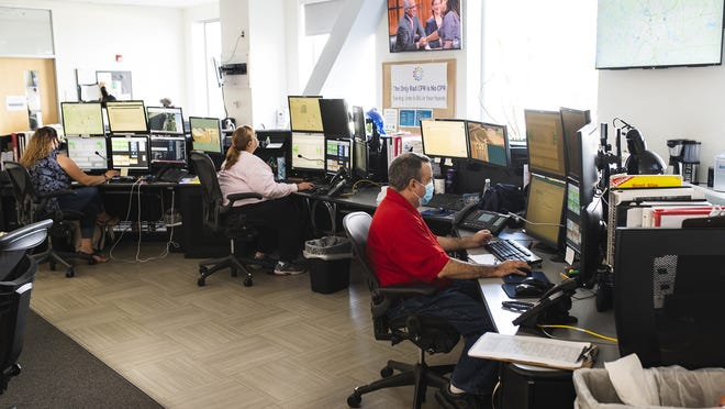 Communication specialists work in the dispatch center at UMass Memorial Medical Center on July 14.