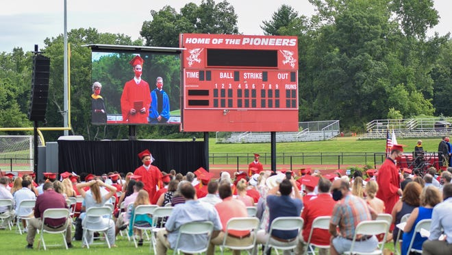 SHREWSBURY - St. John's High School held a socially distanced graduation ceremony on a ballfield on Sunday. Each graduate sat with their family, 6 feet away from others.