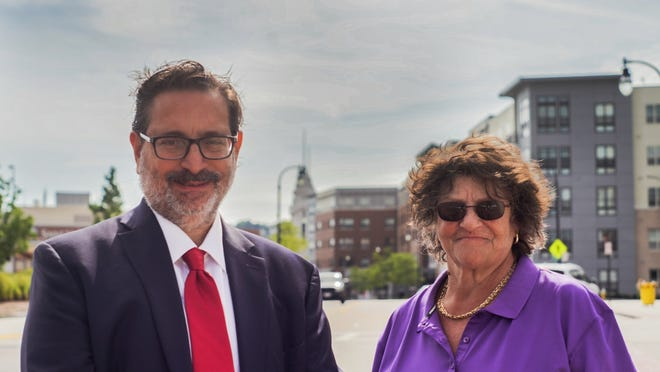 Mauro DePasquale and Carmelita Bello stand on Front Street.