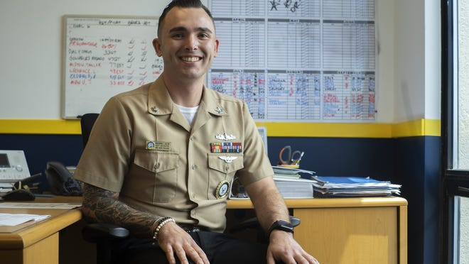 Petty Officer 2nd Class Elias Dalton sits in the Navy recruiting station on Thursday afternoon.