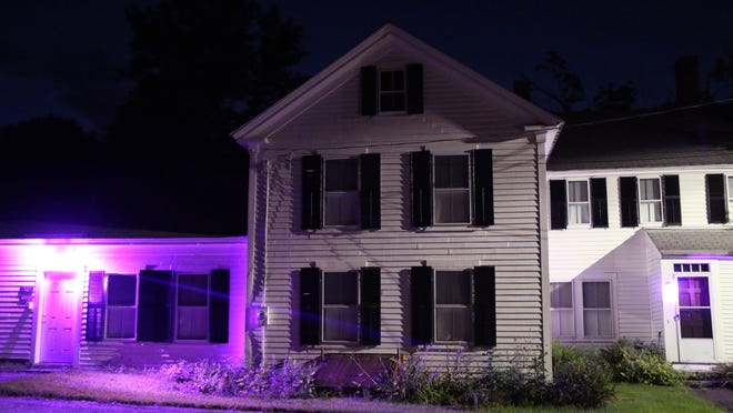 The Sterling Historical Society is lit up in purple in honor of the 100th anniversary of women getting the vote.