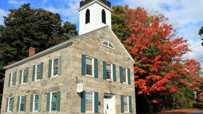 The Boylston Historical Society building is accented by fall colors.