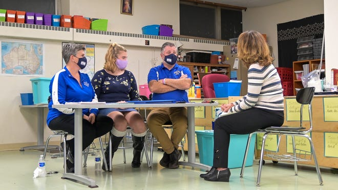From left, Grace Rett's mother, Mary Joe Rett, sister, Brianne Rett, and father, Christopher Rett, talk with Telegram & Gazette reporter Jennifer Toland at the Our Lady of the Valley School in Uxbridge, where a gymnasium and education center will be built in memory of Grace.
