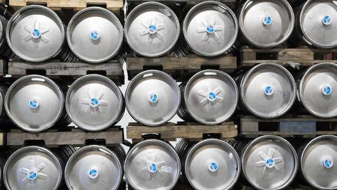 Kegs of product are stored in the warehouse of Atlas Distributing Inc. in Auburn.