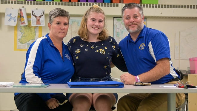 From left, Mary Joe Rett, Brianne Rett and Christopher Rett pose Wednesday at the Our Lady of the Valley School in Uxbridge.