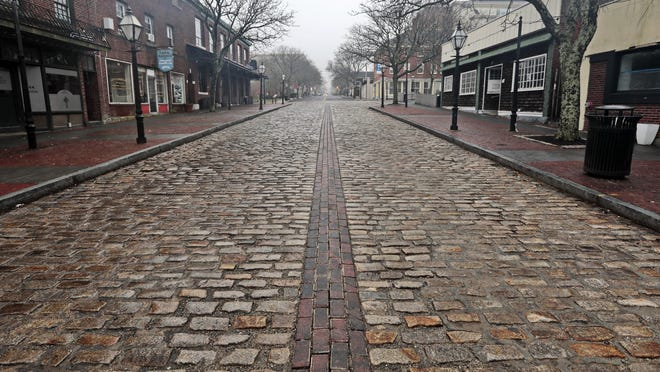 In this March file photo, Union Street in downtown New Bedford is deserted on a Friday morning following the start of the coronavirus lockdown.