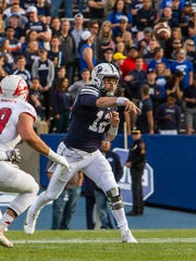 Brigham Young quarterback Tanner Mangum (12) attempts
