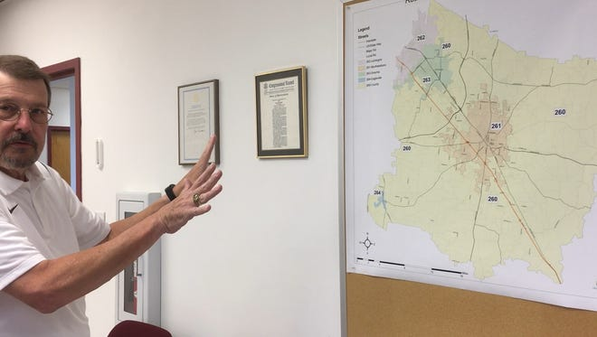 Rutherford County Emergency Communications Department Director Steve Smith explains a map showing the areas covered by local agencies like the one a 911 database will reference to determine where to route a call.