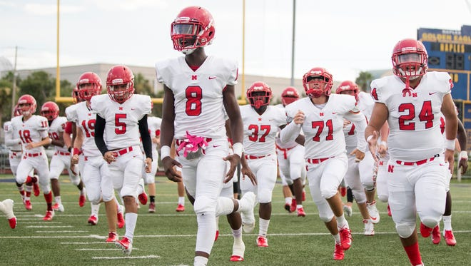 North Fort Myers High School football players take the field against Naples for a preseason game at Staver Field in Naples in August. Naples beat North 25-14.
