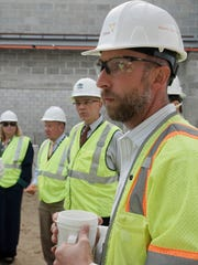 Matt Kennedy, an environmental engineer at OHM, leads the tour. In the background are Treasurer Melissa McLaughlin, Supervisor Phil LaJoy and Municipal Services Director Tim Faas.