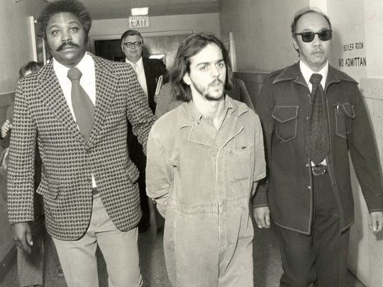 James Carhart, center, fatally shot two police officers and seriously wounded a third on March 28, 1975 in Mount Holly before he was subdued and arrested. (Courier-Post file)