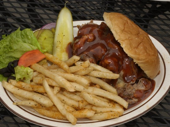 The hickory-smoked  pulled pork sandwich shares top billing with the breaded tenderloin sandwich at Bourbon Street Distillery. The downtown bar and restaurant at 361 Indiana Ave. closes Jan. 6, 2017.