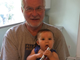 Al Morkunas holds his grand niece Mila Mendenhall, 9 months, while visiting his niece Erin Mendenhall and her family in Salt Lake City, Utah, in July 2016.
