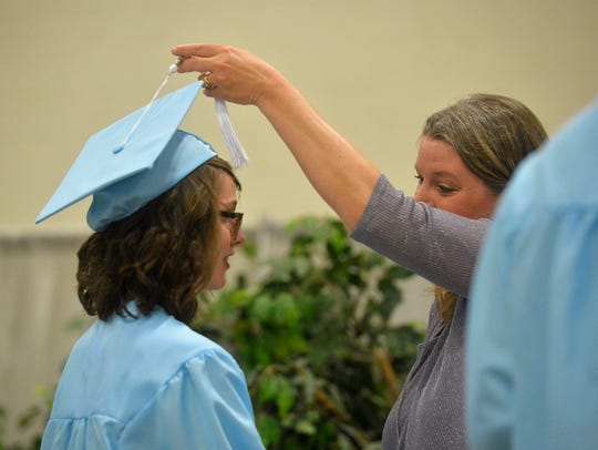 Great Falls High principal Heather Hoyer congratulates