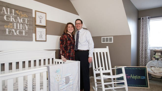 Adrienne and Troy Hagon in the yet to be filled nursery they've prepared in their Williamston home pictured Thursday, March 16, 2017.  They've been married for eight years; they've wanted to have kids, but haven't had luck with fertility treatments so have moved on to adoption.   They've been trying to adopt for the past two years through Catholic Social Services of Washtenaw County but have yet to be chosen.  They made a music video this winter hoping to show their fun sides.