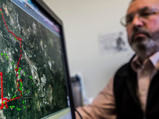 Jeff Cobb, a corrections officer with the state's Burlington Probation and Parole office, shows GPS markers of a Goole map tracking the movements of a person ordered by the courts to be monitored.