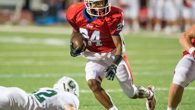 Jackson Prep's Jerrion Ealy (24) scores a second quarter touchdown against Natchez Cathedral.