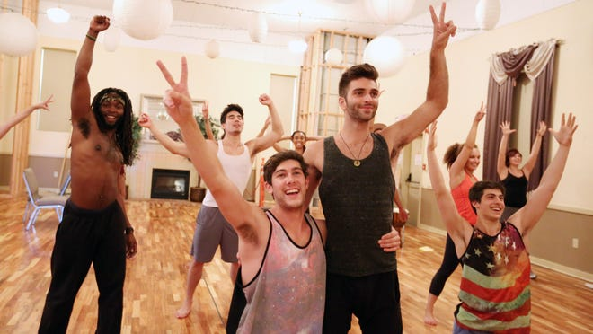 """Drew Shafranek and Jake Bivens, center, and tribe members rehearse scenes for the upcoming production of Enlightened Theatrics' """"Hair: The American Tribal Love-Rock Musical."""" Performances run through Aug. 16 at the Grand Theatre."""