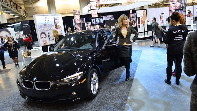 Mary Kay sales professionals check out the latest addition to their fleet, the BMW 320i, at their convention in New Orleans
