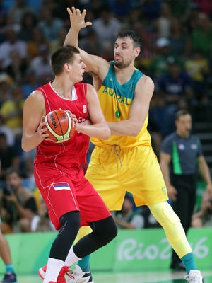 Nikola Jokic, facting off against Australia center Andrew Bogut, is a key in the post for Serbia.