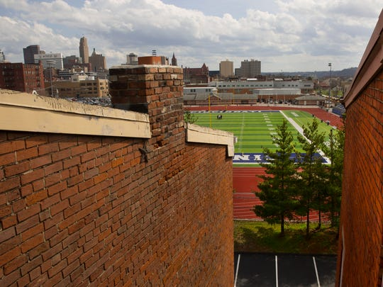 A view from the fourth floor fire escape of condo buildings on Wade Street in the West End. The view overlooks Taft High's Stargel Stadium. Joe and Rosemary Jarvis have purchased five buildings on Wade Street that if developed, will be 22 high-end units. FC Cincinnati has expressed interest in using that site for their soccer stadium.