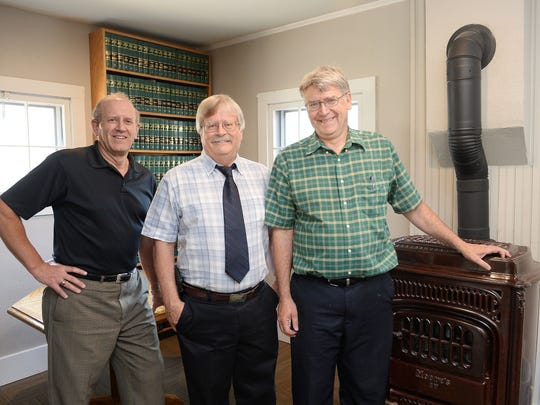 When the March, Olive & Pharris law firm moved their office, they chose a historic fixer-upper on South College Avenue. John Pharris, from left, Stewart Olive and Brad March have been practicing out of the restored home since November 2015.