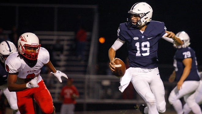 Hunter Helmic (19) and East Lansing can automatically qualify for the playoffs with a win over Okemos next week.