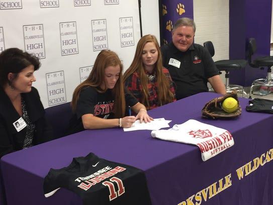 Clarksville High softball player Katie Keen (center)