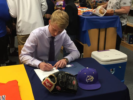 Northeast High pitcher Mitch Rogers signs his letter