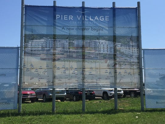 An advertisement for The Lofts at Pier Village, the
