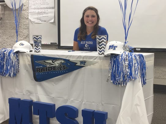 Rossview's Catherine Caudill is all smiles after signing