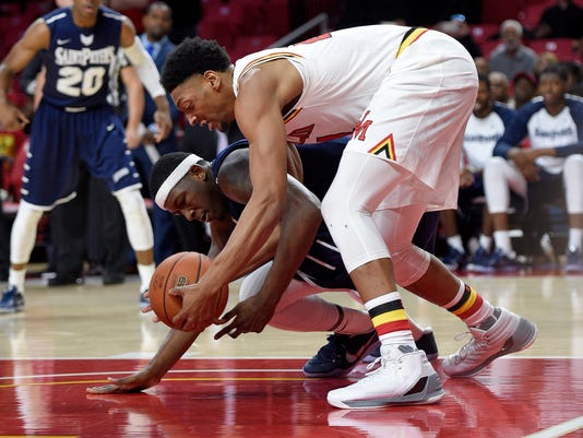 Maryland forward Justin Jackson, front, battles for the ball against St. Peter's center Quadir Welton, back, during the first half of an NCAA college basketball game, Saturday, Dec. 10, 2016, in College Park, Md. (AP Photo/Nick Wass)