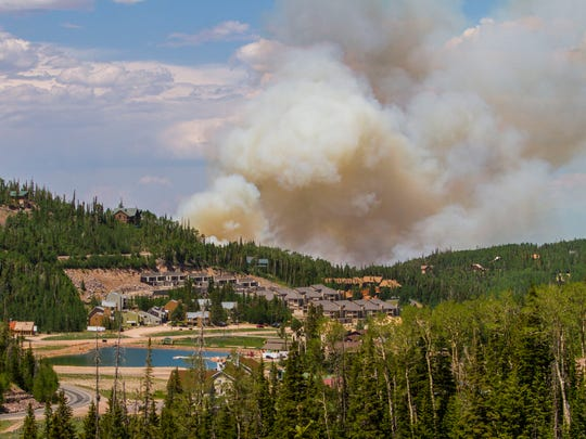 The Brian Head fire continues to burn along Highway 143 on Tuesday, June 20, 2017.