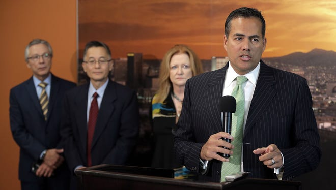 El Paso City Manager Tommy Gonzalez is at right.