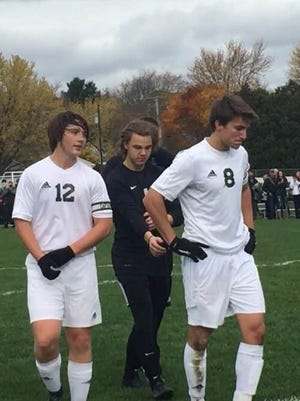 Everest seniors Gunnar Yonker, left, Alex Pagel and Jack Mittelsteadt leave the field after Green Bay Preble's 5-1 win in a Division 1 boys soccer sectional final Saturday.