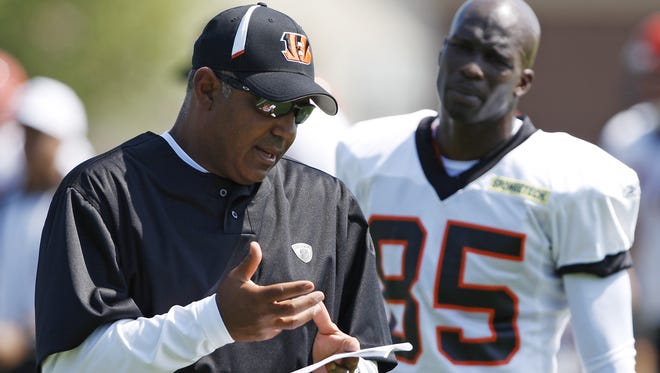 Bengals head coach Marvin Lewis explains a few things to Chad Ochocinco during practice in August of 2009.
