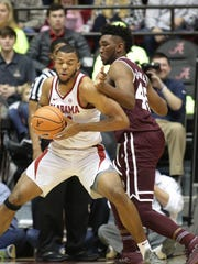 Alabama Crimson Tide forward Galin Smith (30) goes to the basket against Mississippi State Bulldogs center E.J. Datcher (45) during the first half at Coleman Coliseum. Mandatory Credit: Marvin Gentry-USA TODAY Sports