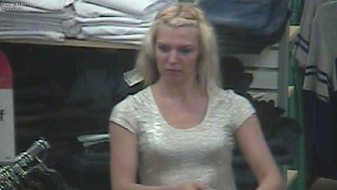 Camarillo police are seeking the public's help in identifying this woman, suspected of leaving a Kmart Friday without paying for merchandise.
