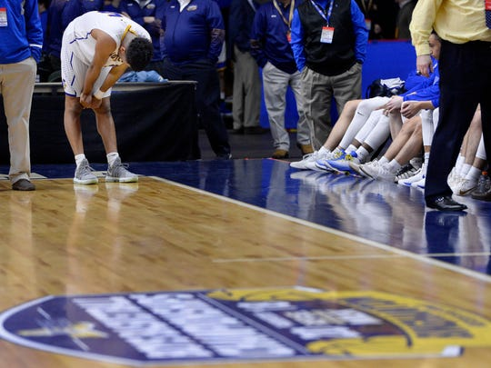 Irondequoit's Patrick Thomas reacts after the Eagles' lost in a Class A semifinal at the 2018 NYSPHSAA Boys Basketball Championships, Saturday, March 17, 2018, in Binghamton, N.Y. Irondequoit's season ended with a 52-42 loss to Amityville-XI.