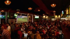 Fans cheer on the U.S. women's soccer team while watching