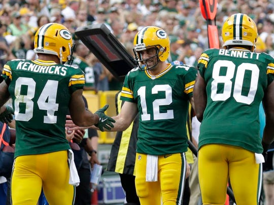 Green Bay Packers quarterback Aaron Rodgers (12) congratulates tight end Lance Kendricks (84) after he scored a touchdown against the Cincinnati Bengals Sunday, September 24, 2017, at Lambeau Field in Green Bay, Wis.