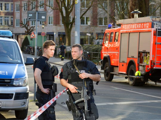Police officers secure the crime scene after a car crashed into a group of people leaving several dead in Muenster, Germany, Saturday, April 7, 2018. (AP Photo/Ferdinand Ostrop)